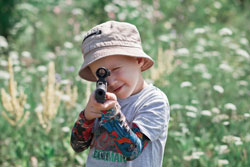 Little boy with bb gun at hunt outside
