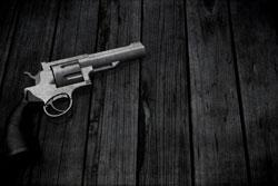 3d handgun on a grunge wooden texture