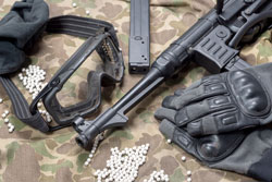Airsoft gun with protective glasses and lot of bullets Isolated