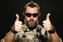 Brutal man in military uniform shows two fingers up