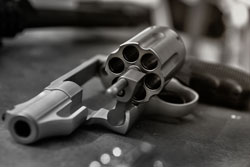 Caliber revolver pistol, revolver open ready to put bullets