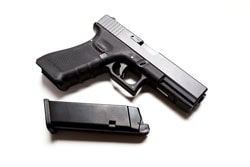 Gun and Magazine on white