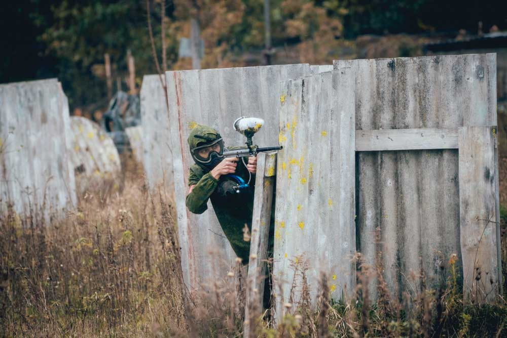 Man with gun playing at paintball