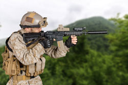 Modern soldier with old rifle