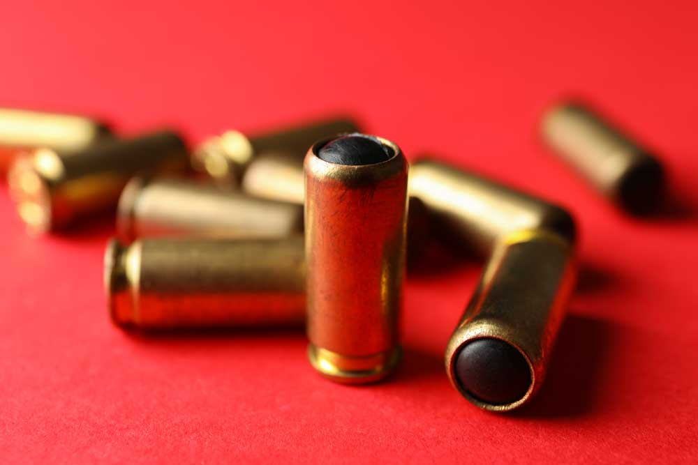 Rubber bullets on red, close up