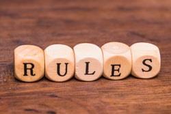 Rule word written on wooden cubes