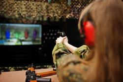 Shooting at the shooting range.the woman at the shooting range shot from gun