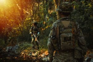Soldier with machine gun patrolling