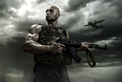 The soldier on a background of storm clouds