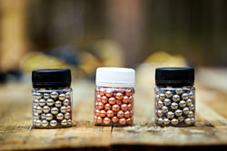 Three pellets for airguns on the table