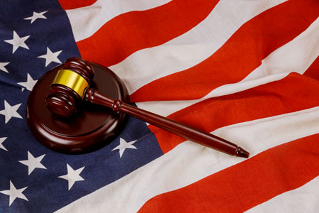 Usa lawyers in the wooden judge hammer on american flag justice law