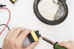 Using soldering iron to fix a connector Free