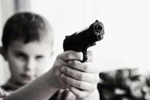 boy aiming toy gun