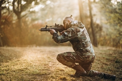soldier playing airsoft outdoors in the forest