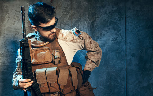 American private military contractor holding rifle