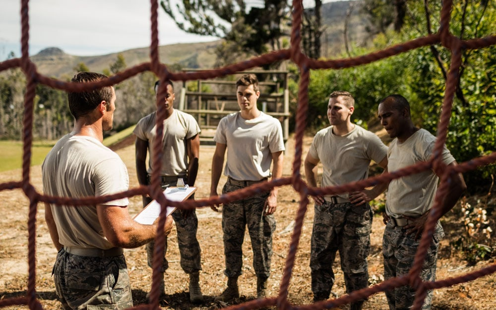 Male trainer instructing soldiers