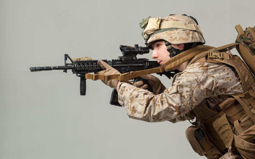Rifleman camouflage holding rifle