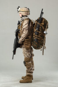Support Gunner camouflage holding rifle