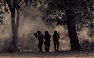 Team of soldiers in the forest