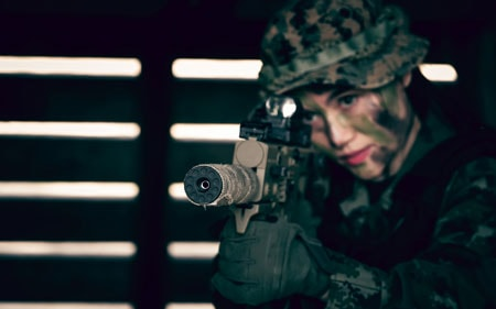 Woman soldier.army soldier with rifle and machine gun