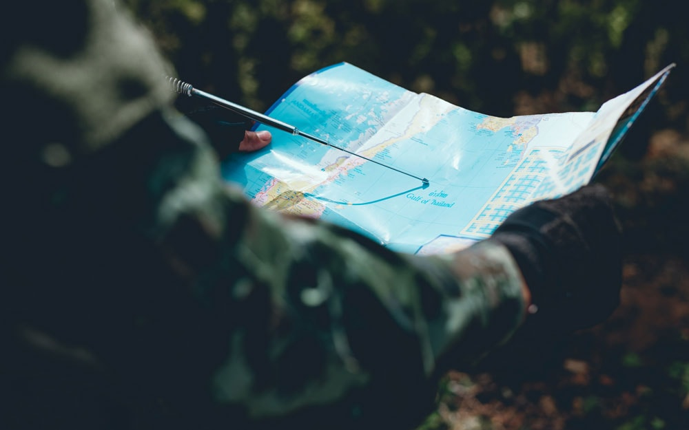 Soldiers are using the radio. and use the map for communication