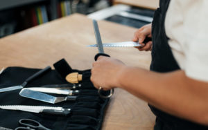 Male chef sharpening his knives