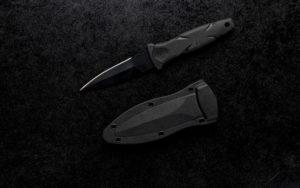 Closeup shot of a small sharp army 420HC Steel knife