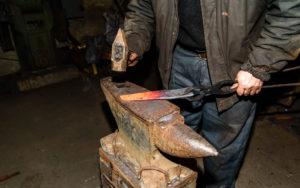 Forging molten metal. making knives