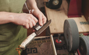 sharpening a knife in the workshop