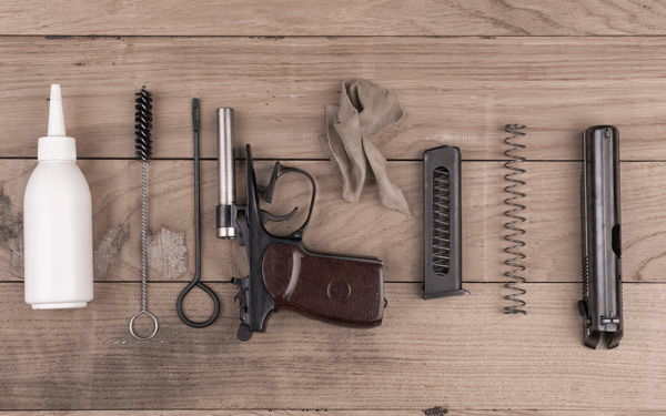 Separate parts of pistol and cleaning kit