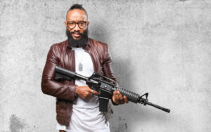 Man holding a submachine gun
