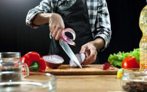 preparing-salad-female-chef-cutting-fresh-vegetables with AUS 8 Steel Knife