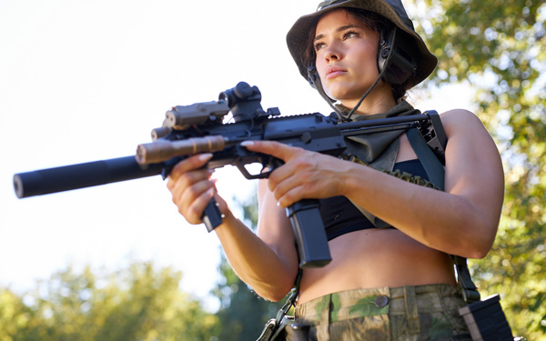 woman soldier shooting with rifle machine gun