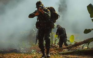 Army soldier in combat uniforms with machine gun