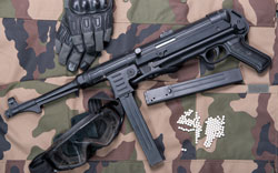 Airsoft rifle with protective glasses, gloves and white bullets