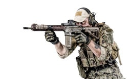 Portrait of special forces soldier in field uniforms with weapons