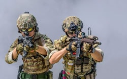 military holding machine guns for ready to attack terrorists